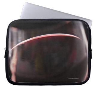 Vidrio de vino rojo funda ordendadores