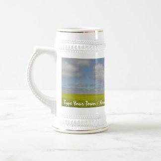 Vidrios de cerveza del paisaje de la pradera de la taza