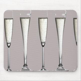 Vidrios de plata del champán alfombrillas de ratón