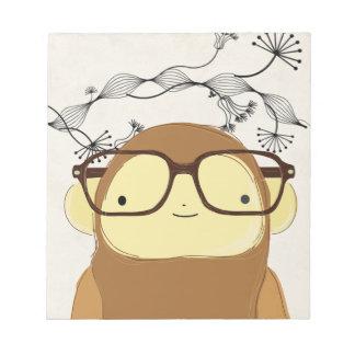 vidrios del mono del empollón bloc de notas