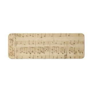 Vieja apariencia vintage de la hoja de música etiqueta de remite