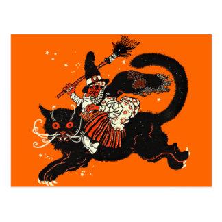 Vieja bruja del vintage que monta un gato negro tarjeta postal
