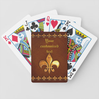 Vieja cubierta de cuero con la flor de lis de oro baraja de cartas