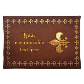 Vieja cubierta de cuero con la flor de lis de oro  mantel individual