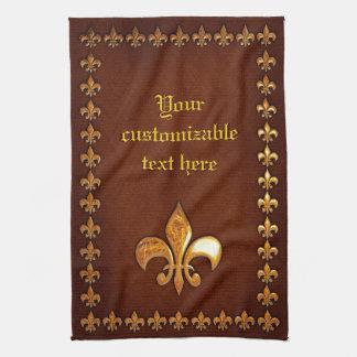 Vieja cubierta de cuero con la flor de lis de oro  toalla de cocina