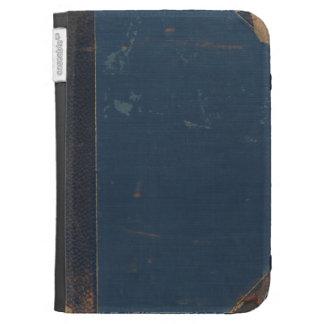 Vieja cubierta de libro azul con los bordes estrop