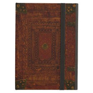 Vieja cubierta del cuero y de libro del latón