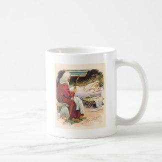 vieja escena del pesebre taza de café