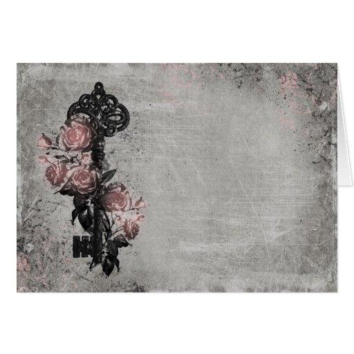 Vieja llave y rosas tarjeta