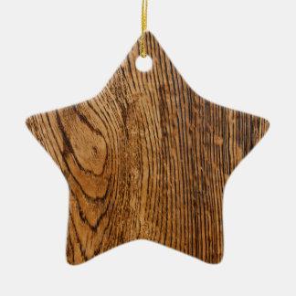 Vieja mirada de madera del grano adorno de cerámica en forma de estrella