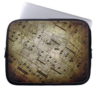 Vieja partitura musical de la hoja, notas de la mú funda computadora