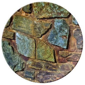 Vieja textura colorida de la pared de piedra platos de cerámica
