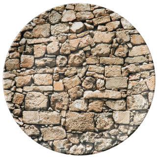 Vieja textura de la pared de piedra plato de cerámica