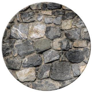 Vieja textura de la pared de piedra platos de cerámica