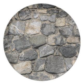 Vieja textura de la pared de piedra plato de cena