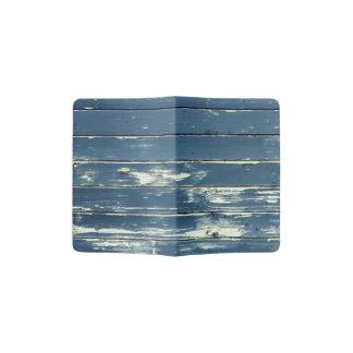 Vieja textura de madera resistida azul de la pared porta pasaporte
