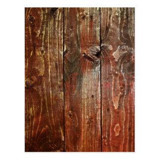 Vieja textura de madera roja de la pared postal