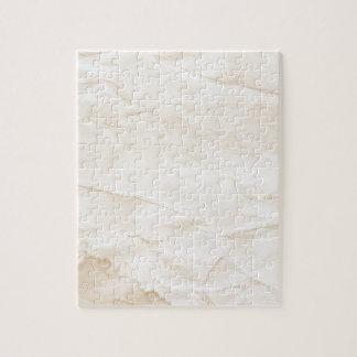 vieja textura de papel con la mancha del café puzzles