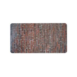 Vieja textura roja de la pared de ladrillo etiqueta de dirección