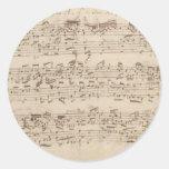 Viejas notas de la música - hoja de música de Bach Etiquetas Redondas