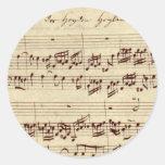 Viejas notas de la música - hoja de música de Bach Etiqueta Redonda