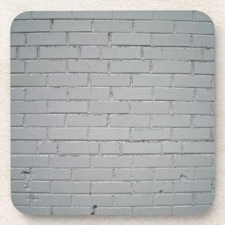 Viejo detalle concreto dañado de la pared de ladri posavaso