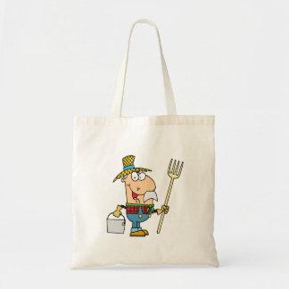viejo dibujo animado divertido del granjero del ma bolsas de mano