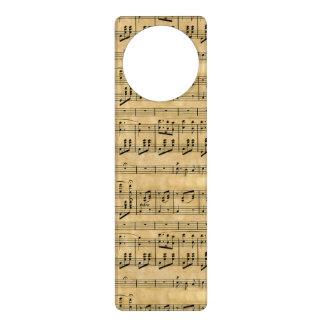 Viejo diseño del papel de pergamino de la partitur colgadores para puertas