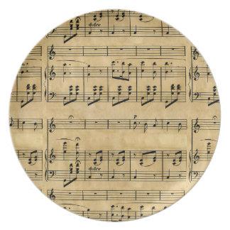 Viejo diseño del papel de pergamino de la partitur plato