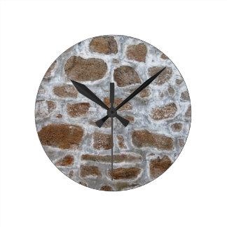 Viejo fondo de la pared de piedra reloj redondo mediano
