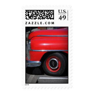 Viejo franqueo rojo del coche de Chevrolet