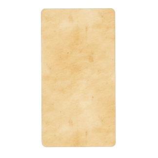 Viejo mirada abigarrada manchada del pergamino etiquetas de envío