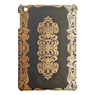 Viejo negro de cuero y oro de la cubierta de libro
