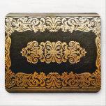 Viejo negro de cuero y oro de la cubierta de libro tapete de raton