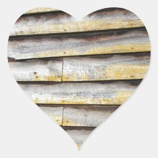 Viejos tableros de madera del tiempo pegatina en forma de corazón