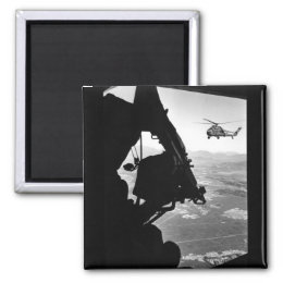 Vietnam:  helicopter and soldier approaching targe magnet