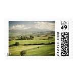 View across Tuscan landscape to farmhouse and 2 Stamps
