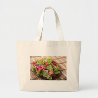 View angle on a fragment of vegetarian salad large tote bag