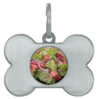 View angle on a fragment of vegetarian salad pet ID tag