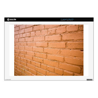 View angle on the red brick wall laptop skin