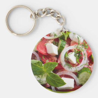 View close-up on a green bowl with a salad keychain