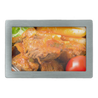View close-up on a meal of beef stew with pasta rectangular belt buckle