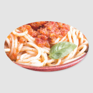 View close-up on a small portion of cooked spaghet oval sticker