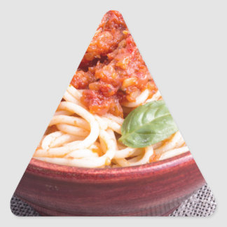 View close-up on a small portion of cooked spaghet triangle sticker