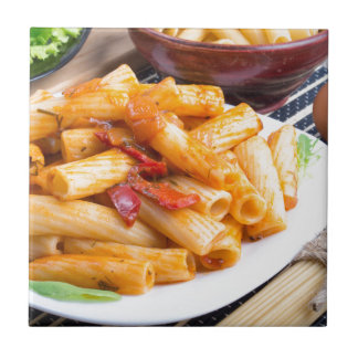 View closeup on a dish of rigatoni pasta tile