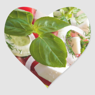 View closeup on a green bowl with a useful salad heart sticker