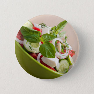 View closeup on a green bowl with a useful salad pinback button