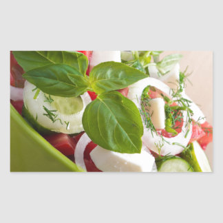 View closeup on a green bowl with a useful salad rectangular sticker