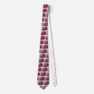 View closeup on hot red chili peppers tie