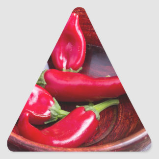View closeup on hot red chili peppers triangle sticker